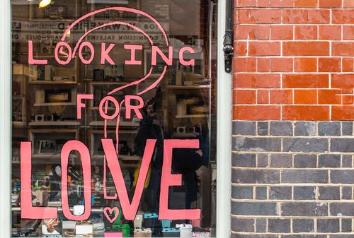 Loveandfriends window in Shoredicth with pink writing that says are you lookng for love